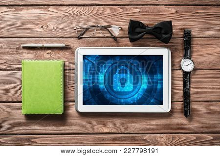 Gentleman Kit Of Tablet Watch Glasses And Notebook On Wooden Table