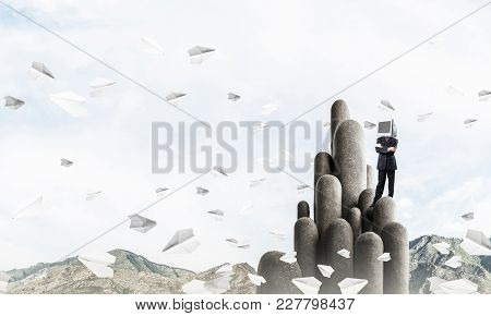 Businessman In Suit With Monitor Instead Of Head Keeping Arms Crossed While Standing On The Top Of S