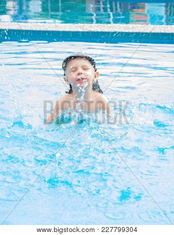Little Boy Swims, Cheerful Child Jumping In The Pool In The Circle, Open-air Swimming Pool, Splash