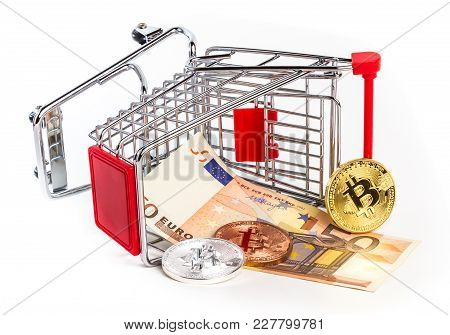 Euro And Physical Metal Bitcoins In Overturned Toy Trolley. Business Concept, Wrong Investment, Cris