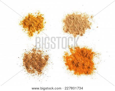 Many Spices Including Ginger Curry Turmeric And Chili Pepper Over White