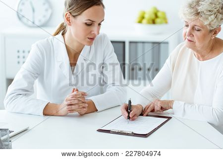 Patient Filling In Medical Questionnaire