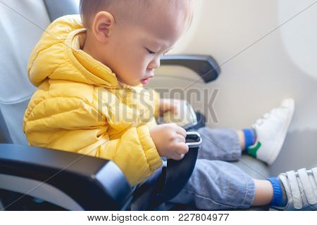 Cute Little Asian 20 Months / 1 Year Old Toddler Baby Boy Child Wearing & Fasten Seat Belts While Si