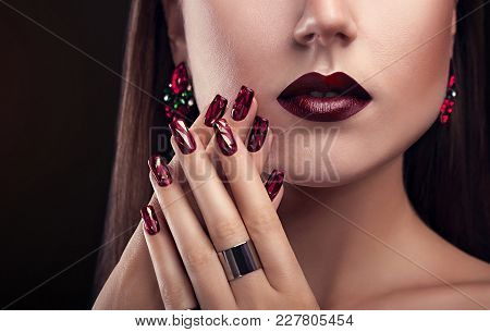 Beautiful Woman With Perfect Make-up And Manicure Wearing Jewellery On Black Background