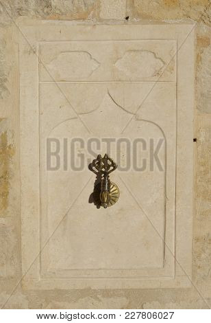 Old Drinking Fountain On The Stone Background