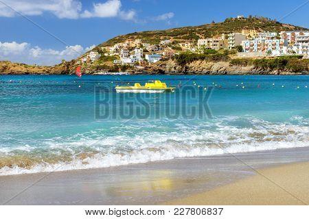 Water Catamaran Parked On Livadi Beach Bali, Crete