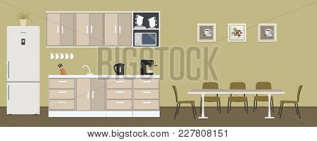 Office Kitchen. Dining Room In The Office. There Is A Fridge, A Table, Chairs, A Microwave, A Kettle