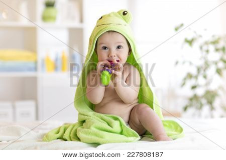 Baby Boy With Green Towel After The Bath Biting Toy