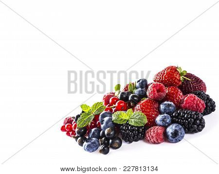 Mix Berries And Fruits Isolated On A White. Ripe Blueberries, Blackberries, Currants, Strawberries A