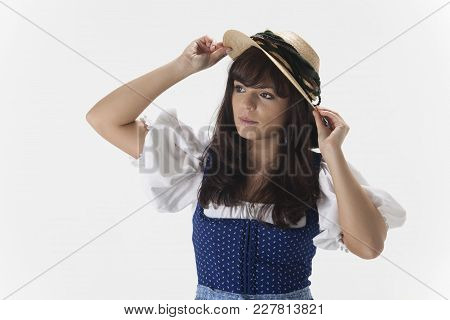 Bavarian Woman In A Dirndl Dress With A Hat