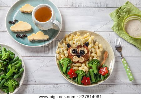 Funny Girl Food Face With Cutlet, Pasta And Vegetables For Kids Lunch