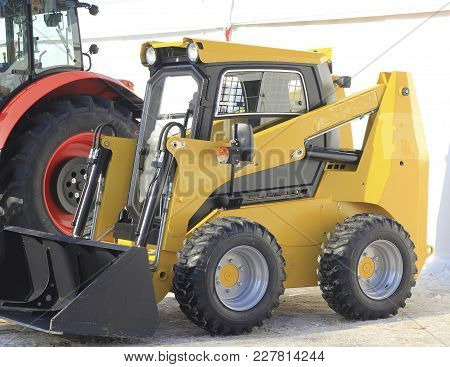 Agricultural Machinery, Front Loader At The Exhibition, Agribusiness And Industrial Concept