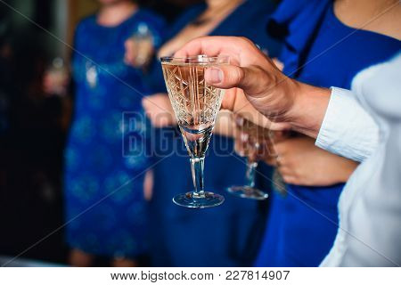 Glass Of Wine In The Hands Of Men At The Festival