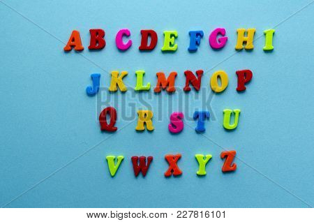 Plastic Magnetic Colored English Alphabet On Blue Background