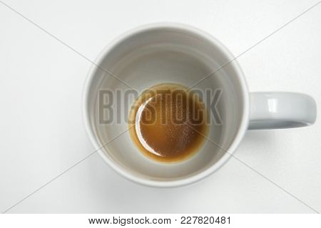 Isolated White Mug With Coffee Stain And Residue At Bottom On Office Desk