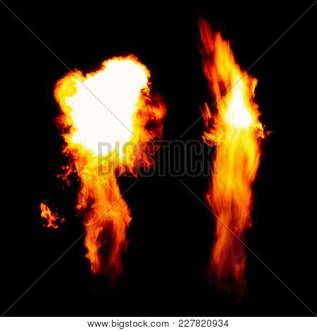 Burning Torch, Flames In The Dark Isolated On Black Background.