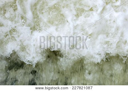 Powerful Waves Of Water With White Foam Rising Up