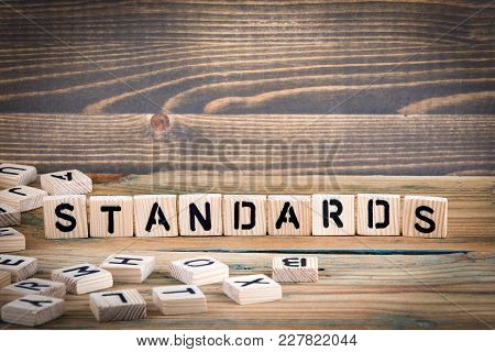 Standards. Wooden Letters On The Office Desk, Informative And Communication Background.