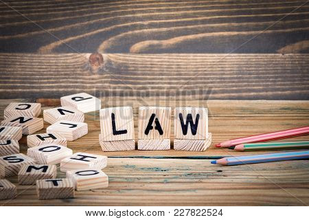 Law. Wooden Letters On The Office Desk, Informative And Communication Background.