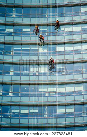 Milan, Italy - September 19,2017: Climber Workers For Glass Cleaning At Porta Garibaldi District, Pi