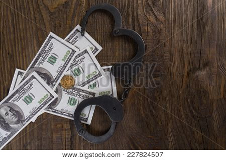 Handcuffs On A Pile Of American Banknotes. The Symbolic Meaning Of Economic Crimes. Copy Paste
