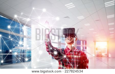 Young Man With Virtual Reality Headset Or 3d Glasses Over Connection Background. Mixed Media
