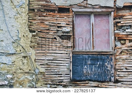 Old Wooden Window And Detail Of A Dilapidated House