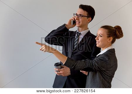 A Portrait Of Two Businesspeople On White Background