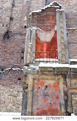 Deteriorated Wall - Facade Of An Old House In Ruins, With Peeled Faded Paint In Yellow, Orange, And