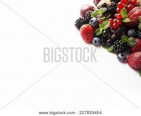 Mix Berries On A White. Berries And Fruits With Copy Space For Text. Black-blue And Red Food. Ripe B