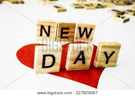 Word New Day. Wooden Letters Spelling The Phrase New Day On White Background. One Red Heart.