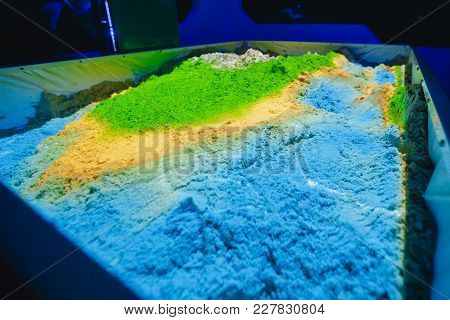 Kinetic Sand. Tray With Sand, Reproduction Of Surface Of Earth, Is Controlled By Smart Projector