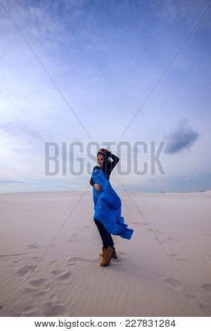 Romantic Expressive Girl, Wearing In A Flying Blue Scarf, Is Walking In The Desert - On The Beginnin