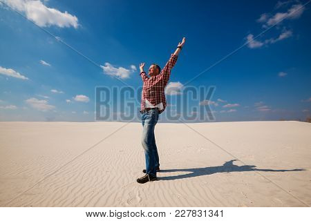 Joyful Tourist, Man Is Enjoying Traveling In The Desert. Caucasian Man In A Plaid Shirt,  With Open