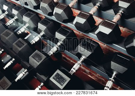 Dumbbell. Rows Of Dumbbells In Gym With Loft Modern Gym