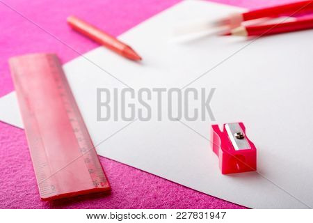 Red Pencil With Pencil Sharpener, Ruler And Felt Pen On White Paper Sheet. Stationery. Office Tool.