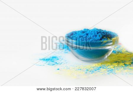 Indian Holi Festival Blue Colour In Bowl On White Background. With Text Space