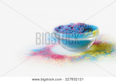 Indian Holi Festival. Mix Of Blue And Pink Colours In Bowl On White Background. With Text Space