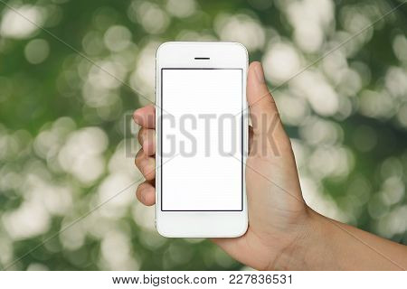 Hand Holding Smartphone On Abstract Bokeh Background