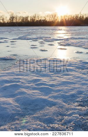 Fishing On The River In Winter, Snowy Islands On The Frozen Water