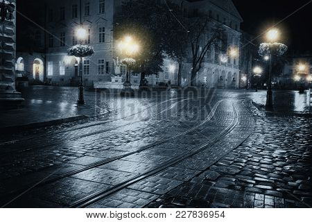 Old European Dark City At Rainy Night