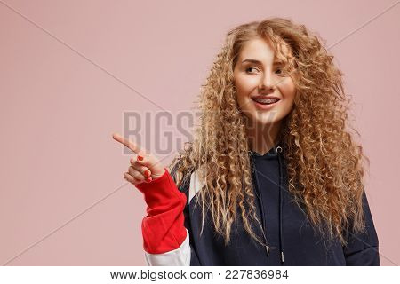 Portrait Of Beautiful Joyful Blonde Caucasian Female Smiling, Demonstrating White Teeth With Braces,