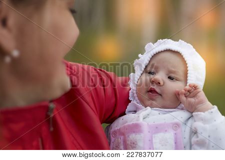 Small Baby On Mothers Hands. Motherhood. Maternity. Top View. Mother Holding Her Cute Baby