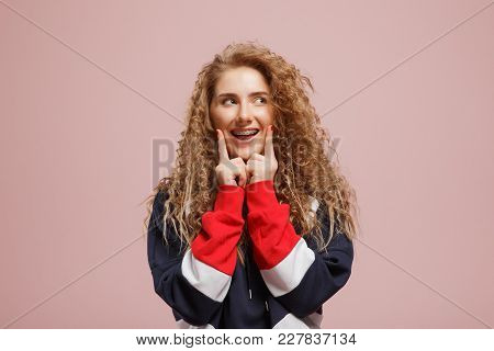 Girl Looks Happily Empty Place, Index Fingers On Her Face, Concept Of Eureka, Discovery, Brilliant T