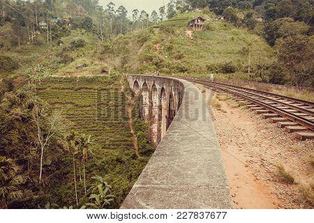 Ella, Sri Lanka - Jan 2, 2017: Village People Walk On Old Nine Arches Bridge In Beautiful Tropical L