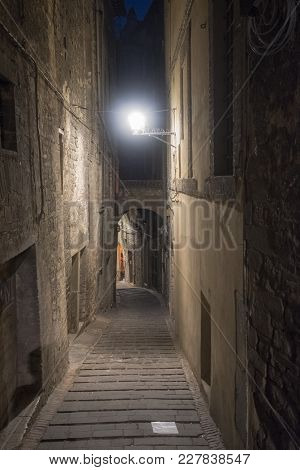 Historic Buildings Of Perugia, Umbria, Italy, At Evening. Typical Street