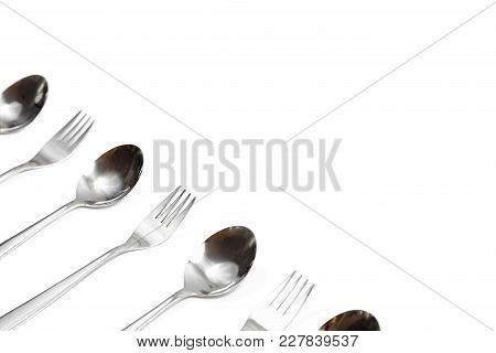 Cutlery On A White Isolate The Top View.