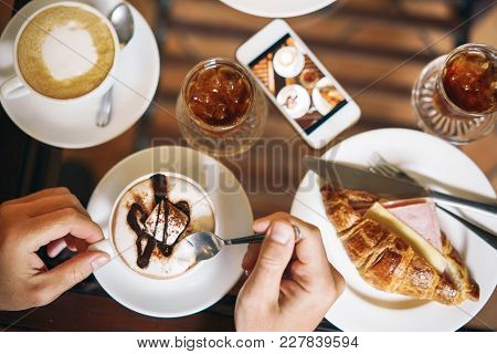 Morning Breakfast For Two: A Croissant With Ham, Coffee, A Refreshing Drink. Male Hands Holding A Cu