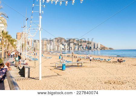 Benidorm, Spain - February 15, 2018: People Enjoying Holiday In The Beach Of Benidorm, Costa Blanca,