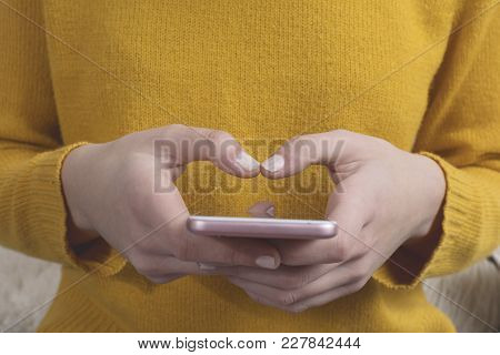 Closeup Of Woman Texting With Smartphone